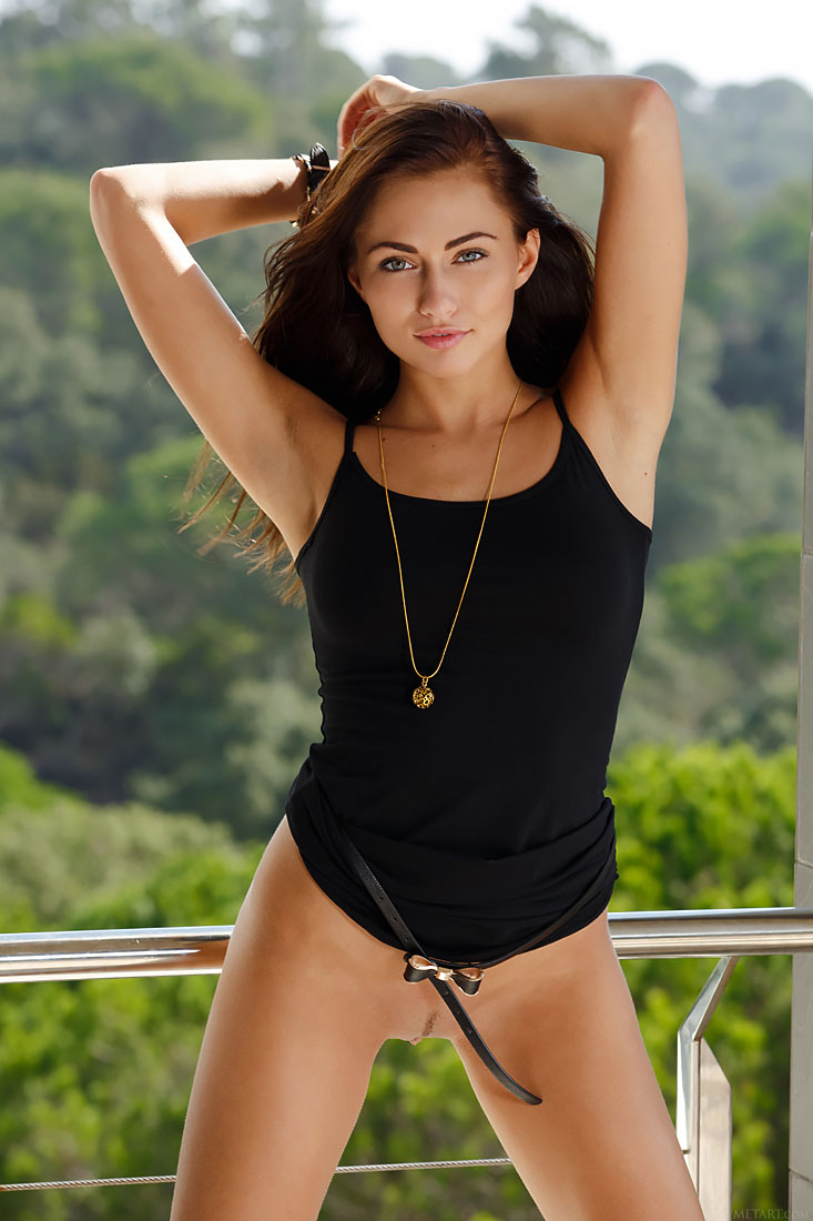 Michaela Isizzu strips outdoors baring her lusty body on